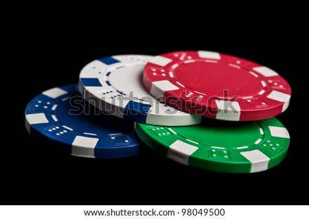 poker chips isolated on a black background