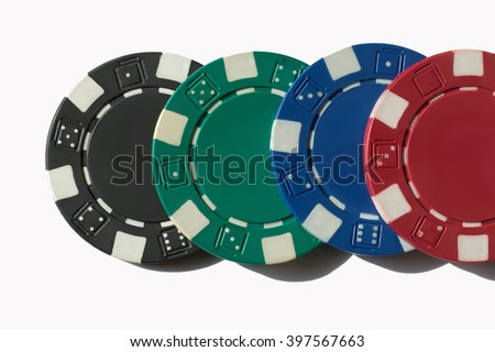 Poker chips isolated.Poker chips for casino game on the table. Red Green Blue and Black Poker Chips Isolated On White Background.