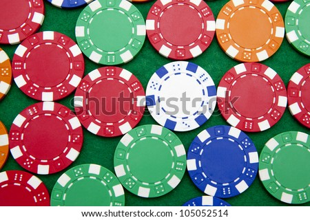 Poker chips on a green casino table