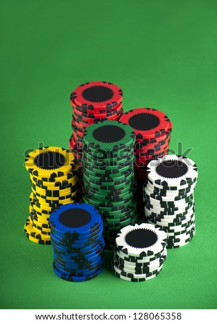 poker chips on a green table background - stock photo