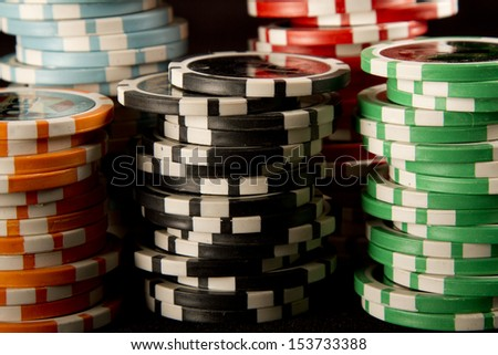 Poker chips on black background