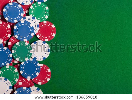 Poker chips on green  background with place for sample text