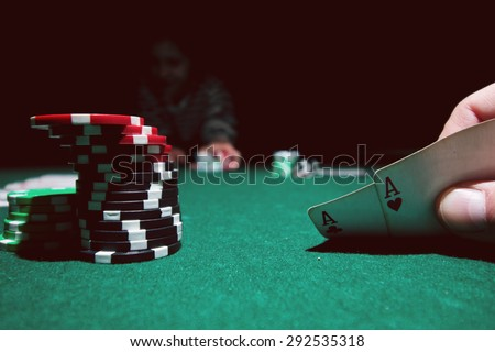 poker chips on the cloth combination of cards - stock photo