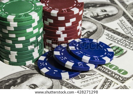Poker chips on the dollars