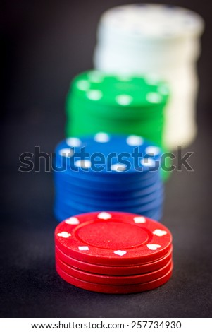 Poker chips stack in a row - stock photo