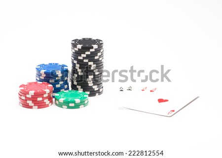 Poker chips with cards isolated on white background - stock photo