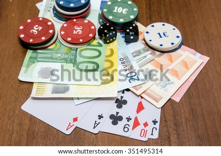 poker chips with playing card, euro on table
