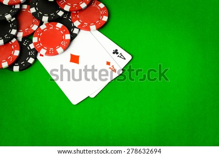 Poker cloth, a deck of cards, poker hand and chips. Background. - stock photo