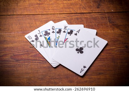 Poker. Combination Royal Flush clubs - stock photo