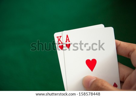 Poker concept with cards on green table