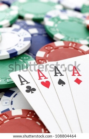 poker, four aces of a kind with chips background