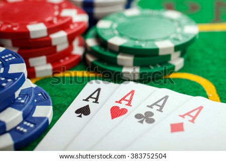 poker four aces on green casino table - stock photo