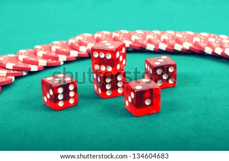 Poker gambling chips on a green playing table, stacks of poker chips , casino concept