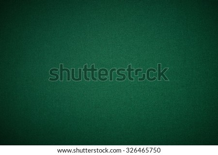 Poker green table in casino with lighting - stock photo