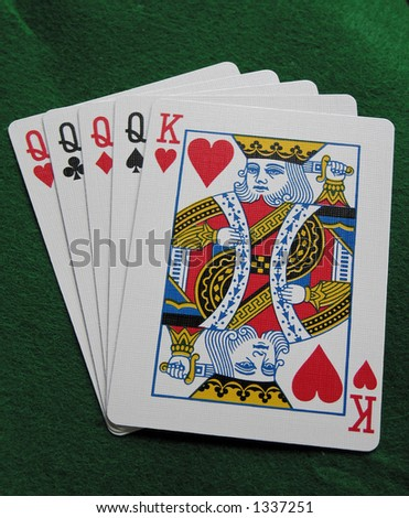 poker hand on green felt with - stock photo