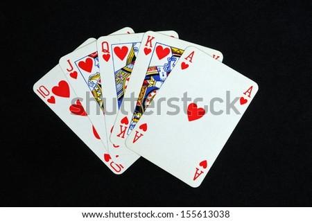 Poker hand, Royal Flush against a black background. - stock photo