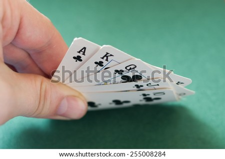 Poker Hands.  Royal Flush on green background - stock photo