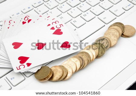 Poker, money and computer keyboard (the expression of an online poker game, or against the concept of online gambling)