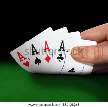 Poker of aces in hand closeup - stock photo