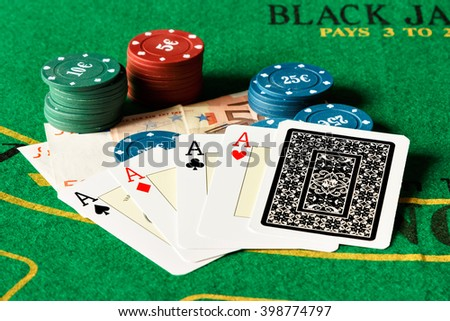 Poker of aces with poker chips on a poker table. Horizontal image.