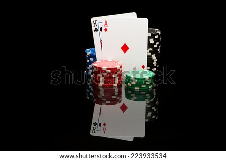 Poker pair on black background with reflexion - stock photo