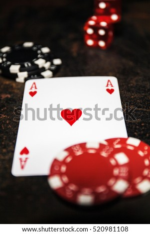 Poker play. Ace of hearts, poker chips, dice.