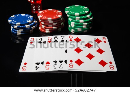 Poker play. Poker cards and chips,dice. Street hand.