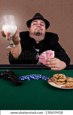 Poker player holding a glass of milk, close up. - stock photo