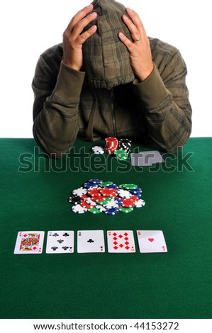 Poker player holding head in despair - stock photo