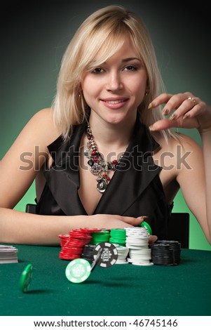 Poker player in casino with cards and chips on green background
