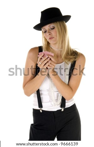 Poker player in suspenders and a fedora studies her cards