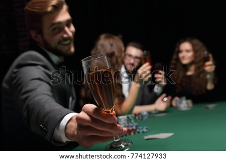 poker player with a glass of wine