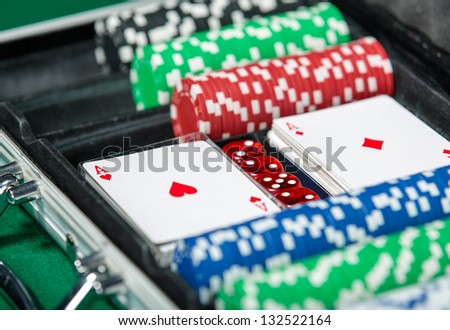 Poker set in metal suitcase. Risky entertainment of gambling - stock photo