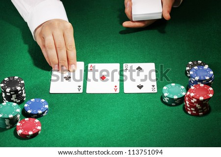 Poker setting on green table - stock photo