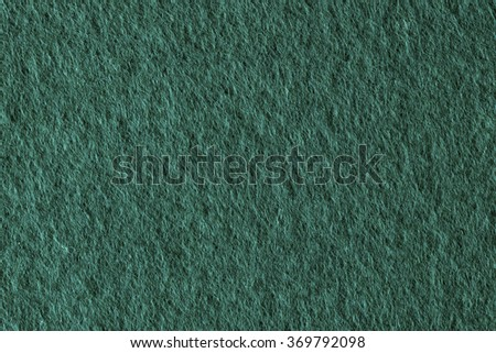 Poker table felt background in green color. - stock photo