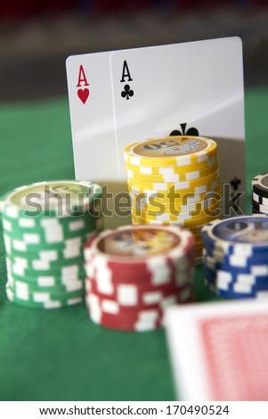 Poker, two aces and gambling chips - stock photo