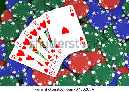 Poker winning hand over a colorful chips background.