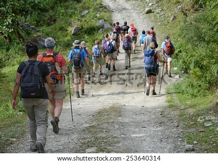 POKHARA - OCTOBER 26: people hike the Annapurna trail on October 26, 2014 in Pokhara region, Nepal. Trekking is not without dangers. Snowstorms have killed 39 trekkers earlier this year on 14 October. - stock photo