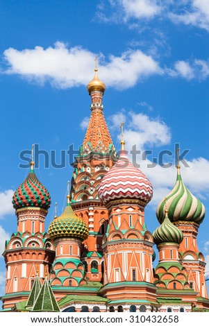 Pokrovsky cathedral on Red Square in Moscow and blue sky with white clouds in sunny summer day - stock photo