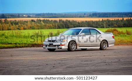 Poland - August17,2016: Beautiful elegant car on a field background. Autumn trip. Modern vehicle. Nice weekend outdoors. Amazing rural landscape. Wonderful journey. European countryside