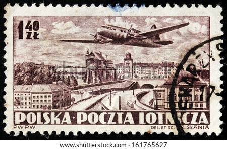 POLAND - CIRCA 1952: A stamp printed by POLAND shows airplane and bird's-eye view of  Warsaw, circa 1952