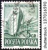 "POLAND - CIRCA 1952: A stamp printed in Poland from the ""Gdansk Shipyards"" issue shows shipbuilding, circa 1952. - stock photo"