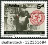 POLAND - CIRCA 1984: A stamp printed in Poland shows a scout taking mail, photo taken by Jerzy Tomaszewski, devoted 40th anniversary of Warsaw Uprising, circa 1984 - stock photo