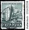"POLAND - CIRCA 1952: A stamp printed in Poland shows Gdansk Shipyards, with the inscription ""Reconstruction of Gdansk shipyards"", from the series ""Shipbuilding"", circa 1952 - stock photo"