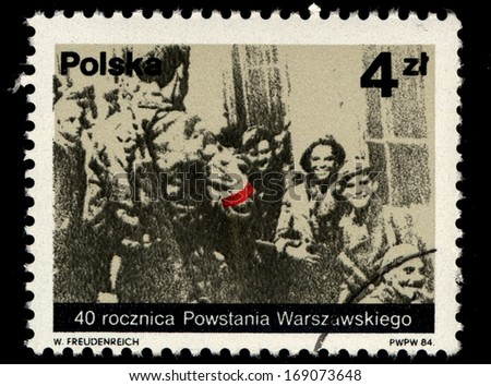 "POLAND - CIRCA 1984: A stamp printed in Poland shows Polish partisans from old photo, with inscription and name of series ""40th anniversary of Warsaw Uprising"", circa 1984"