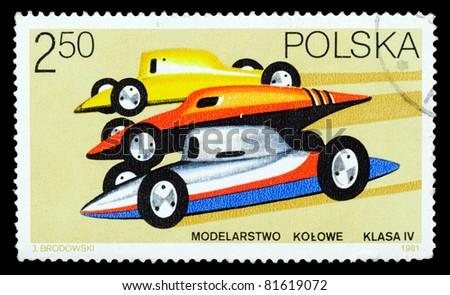 POLAND - CIRCA 1981: A stamp printed in Poland shows racing cars in Class IV, circa 1981 - stock photo