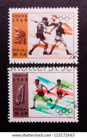 POLAND - CIRCA 1968: A stamp printed in Poland shows the olympic boxers and runners, circa 1968.