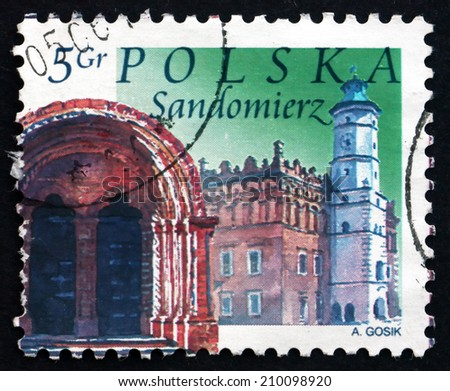 POLAND - CIRCA 2004: a stamp printed in the Poland shows Town Hall and Church Archway, Sandomierz, circa 2004