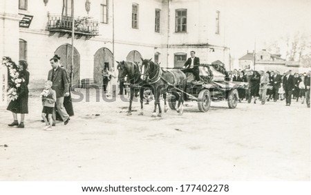 POLAND, CIRCA FORTIES - Vintage photo of funeral procession with a horse drawn hearse - stock photo