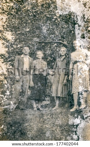 POLAND, CIRCA FORTIES - Vintage photo of group of people in forest